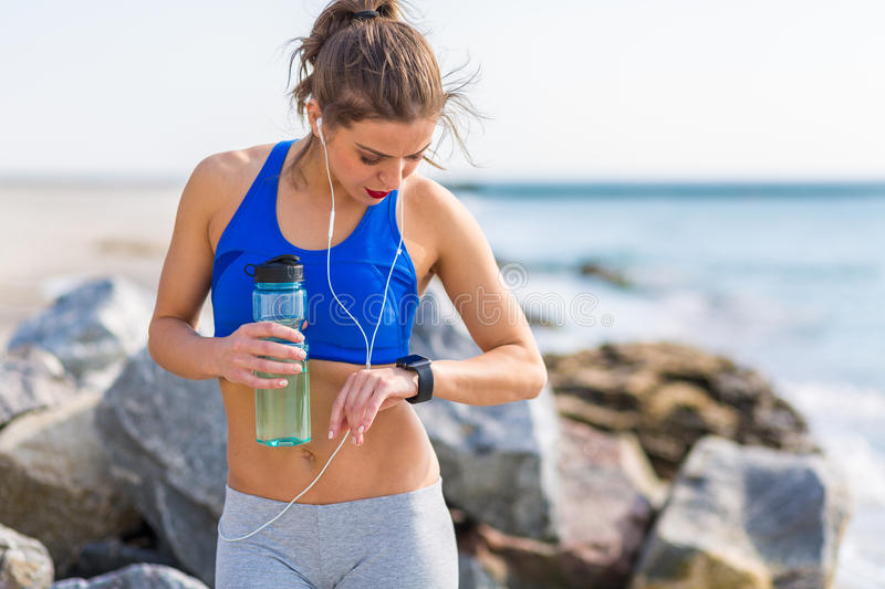 Woman working out at the beach. Woman working out outdoors in the summer at the beach stock photos