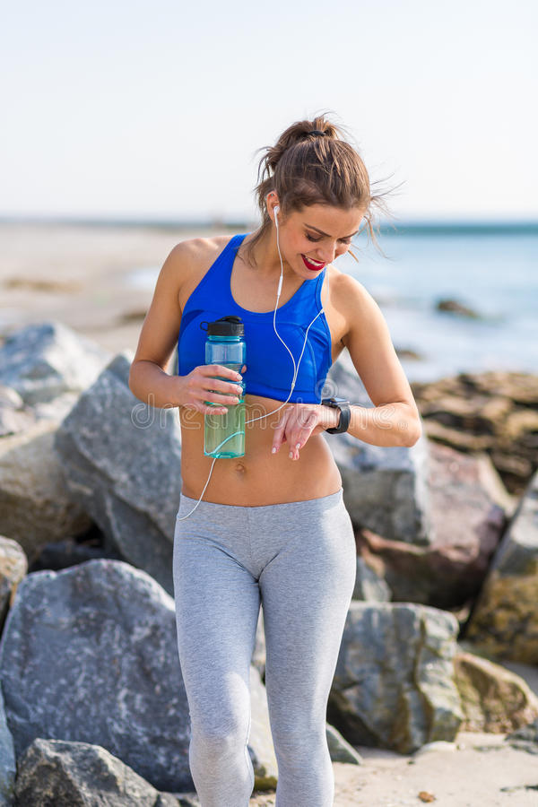 Woman working out at the beach. Woman working out outdoors in the summer at the beach stock images