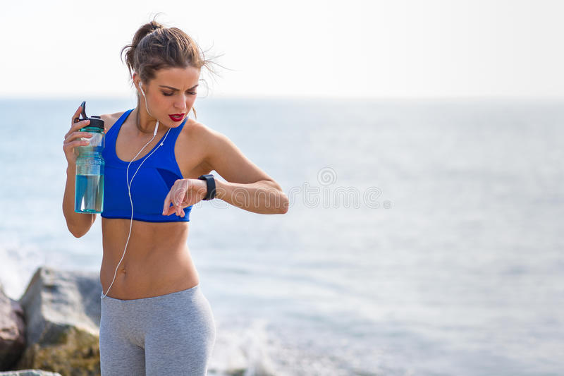 Woman working out at the beach. Woman working out outdoors in the summer at the beach royalty free stock photo