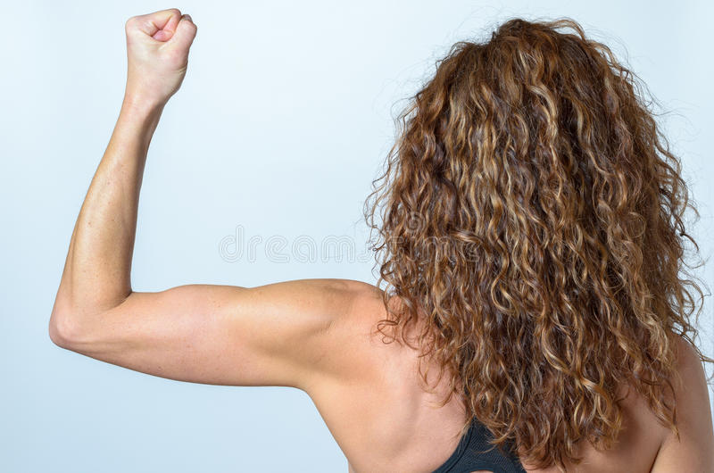 Woman working out with a dumbbel royalty free stock photography