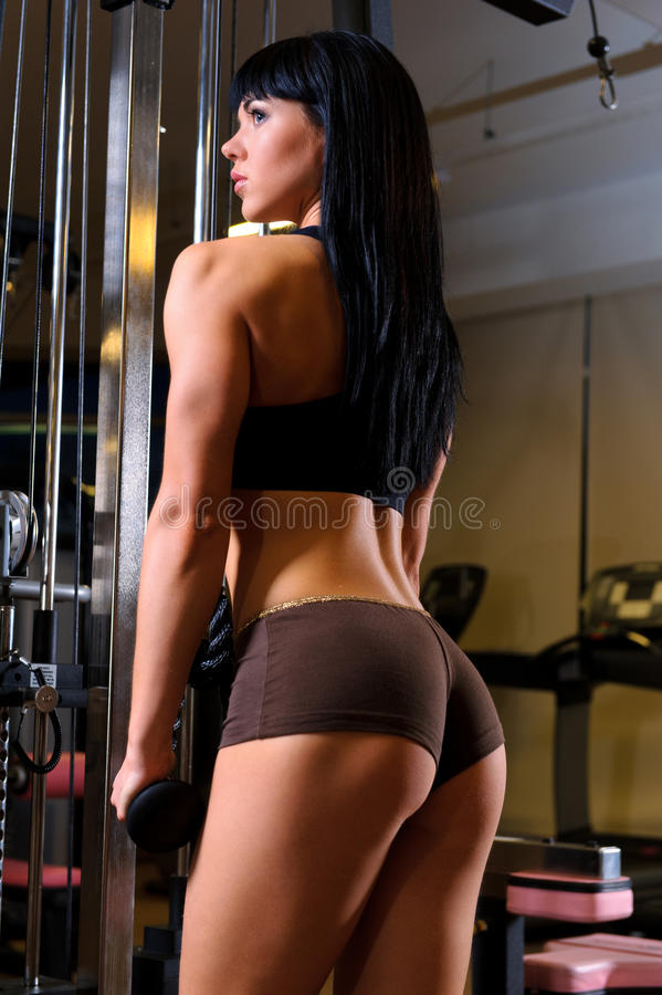 Woman Working Out In Fitness Club Stock Photography