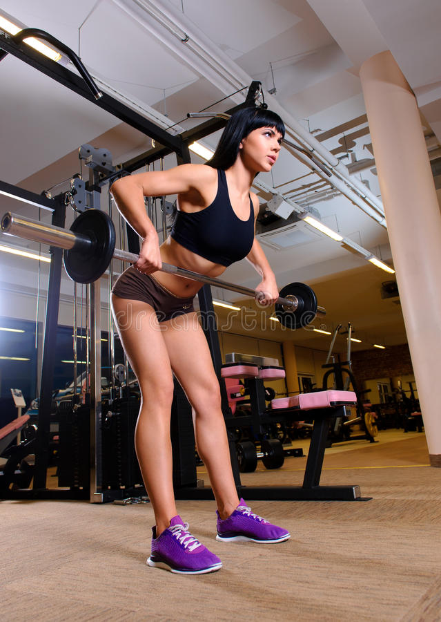 Woman working out in fitness club royalty free stock images