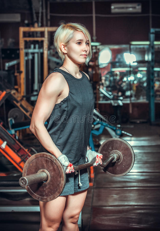 Woman working out in fitness royalty free stock image