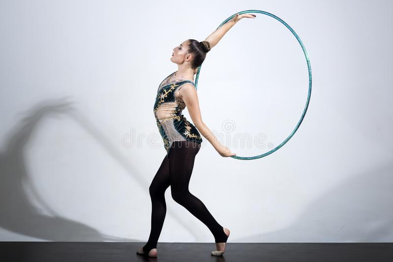 Woman working out with hoola hoop in studio. Woman working out with hoola hoop in studio royalty free stock photo