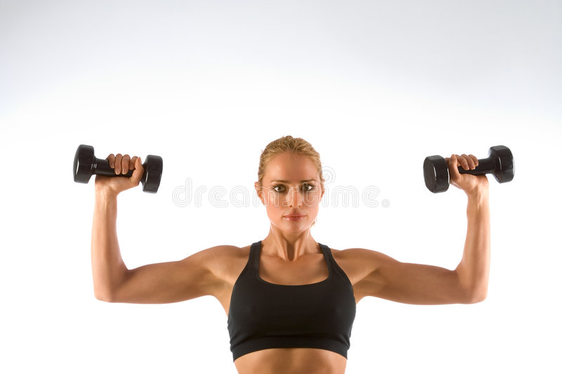 Woman Working-out lifting stock photo