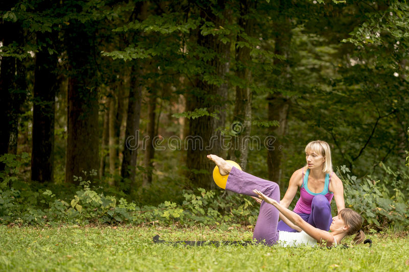 Woman working out with a personal trainer royalty free stock photography
