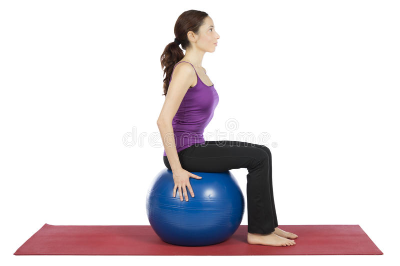 Woman working out with a pilates ball royalty free stock photos