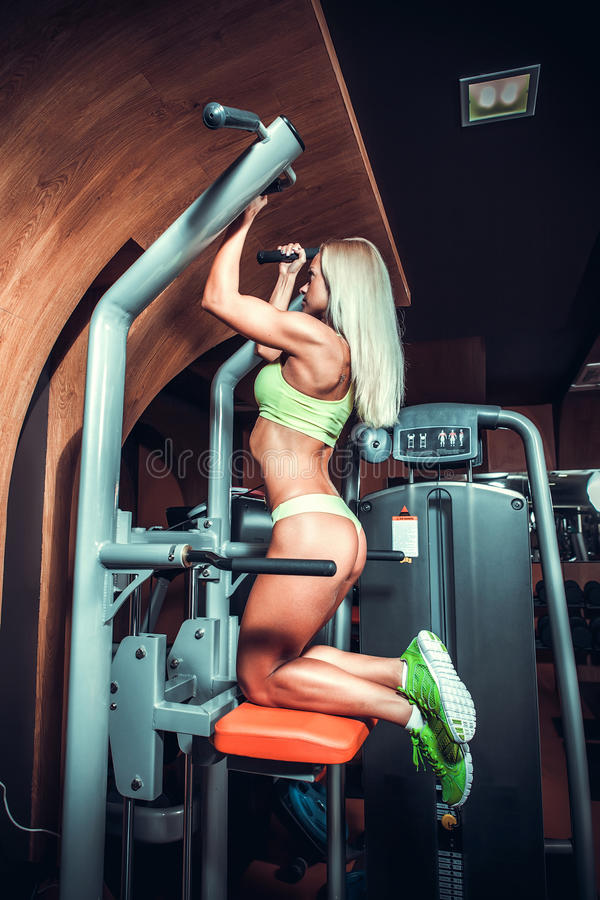 Woman working out - pull ups stock photo