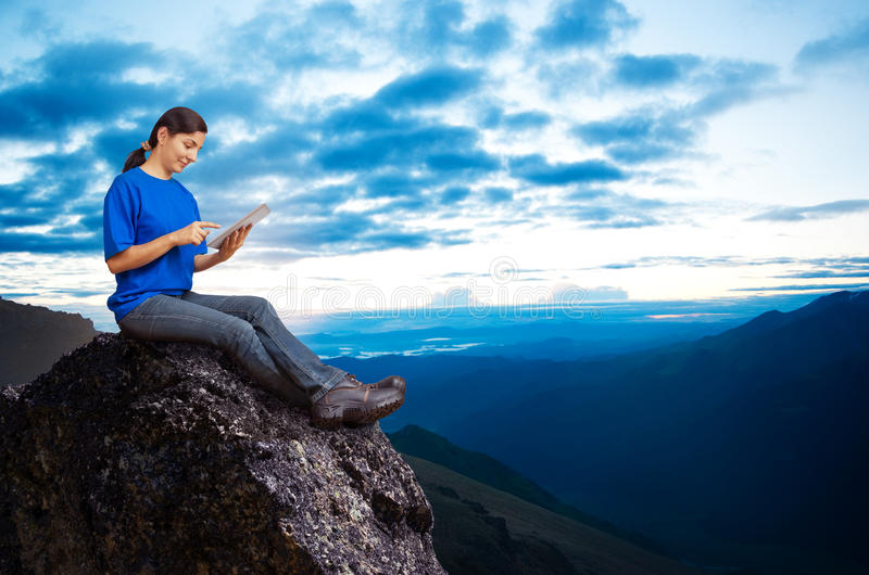 Woman working outdoors royalty free stock image