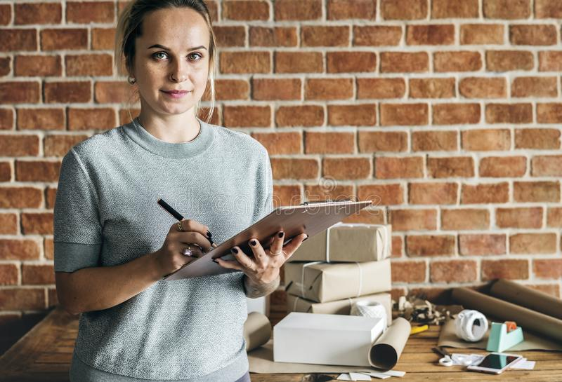 Woman working at parcel service royalty free stock photography