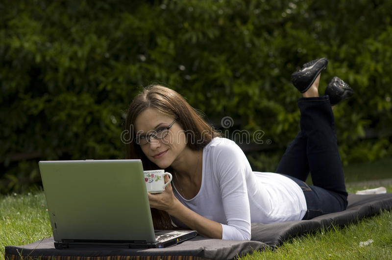 Download Woman Working Coffee Cup In The Park Stock Photo - Image: 18641324