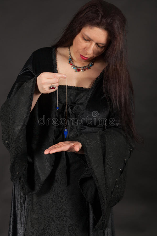 Download A Woman Is Working With A Pendulum Stock Photo - Image: 27682320