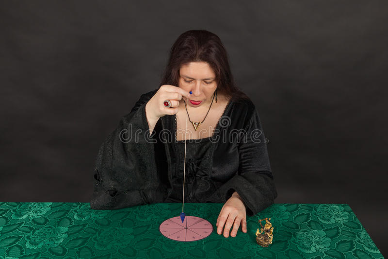 Download A Woman Is Working With A Pendulum Stock Image - Image: 27682689