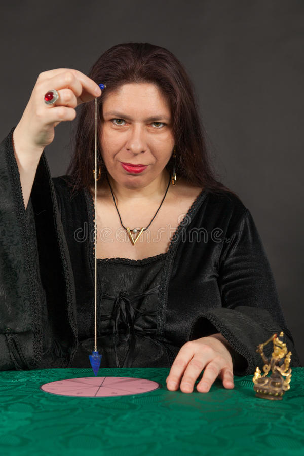 Download A Woman Is Working With A Pendulum Stock Photo - Image of teller, esoteric: 27682692