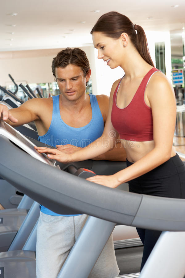 Woman Working With Personal Trainer stock photography