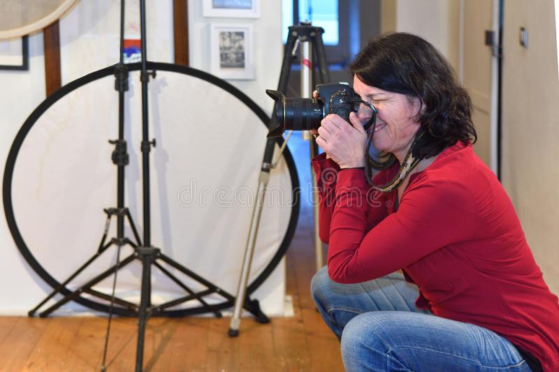 Woman working in a photography studio stock images