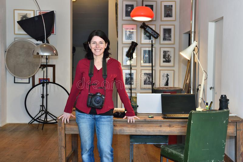 Woman working in a photography studio royalty free stock photos