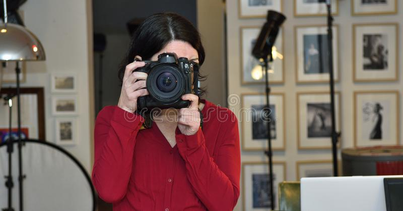 Woman working in a photography studio royalty free stock images