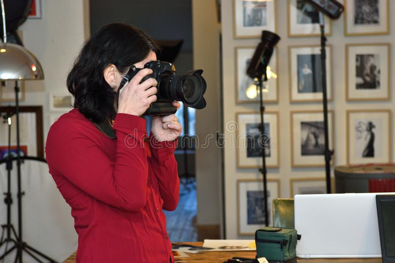 Woman working in a photography studio stock image