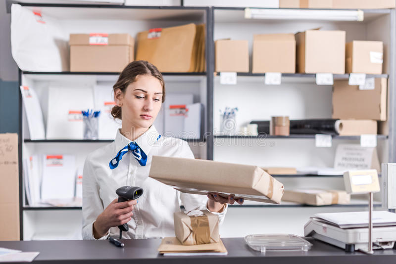 Woman working at the post office. Young woman working at the post office stock images
