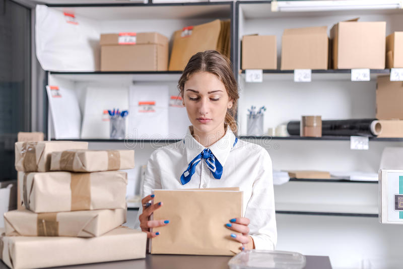 Woman working at the post office. Young woman working at the post office stock photos