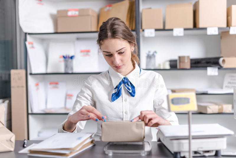 Woman working at the post office. Young woman working at the post office stock photo