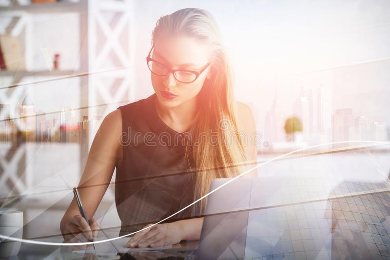 Woman working on project royalty free stock photography