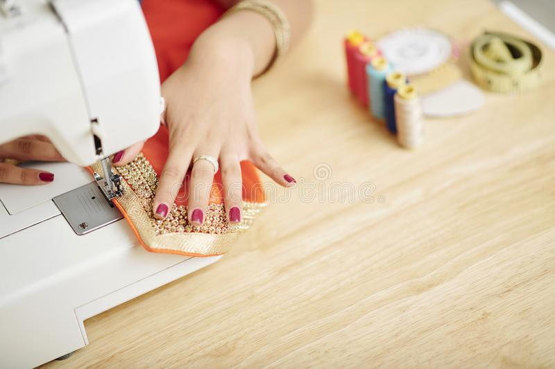 Woman working on sewing machine stock photos