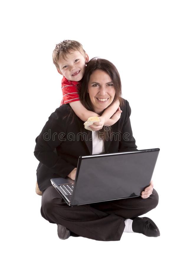 Woman working and son on neck. royalty free stock photography