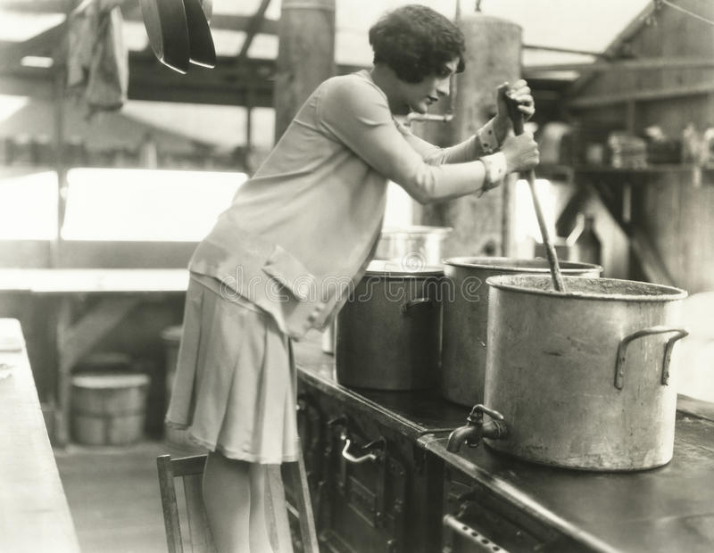 Woman working in soup kitchen stock photos