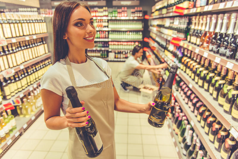 Woman working in the supermarket stock images