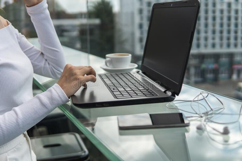 A woman is working by using a laptop computer on table. Hands typing on a keyboard. Female businessman is typing on a royalty free stock photos