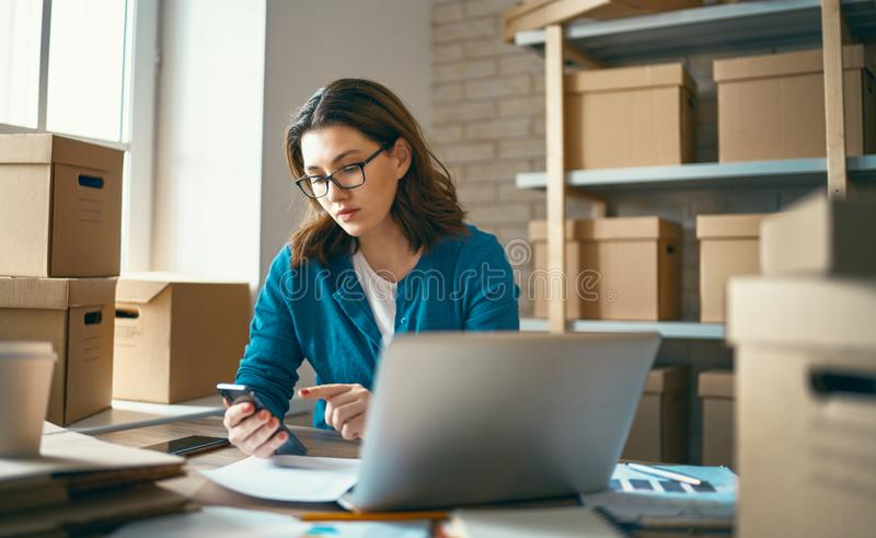 Woman is working at warehouse for online store stock photos