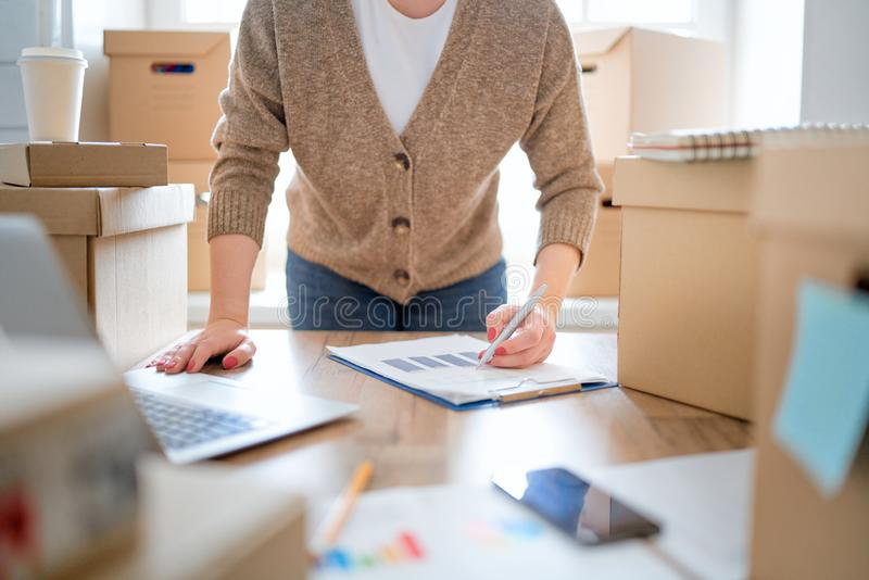 Woman is working at warehouse for online store. Woman is working at warehouse for online seller. Concept of small web business royalty free stock photography