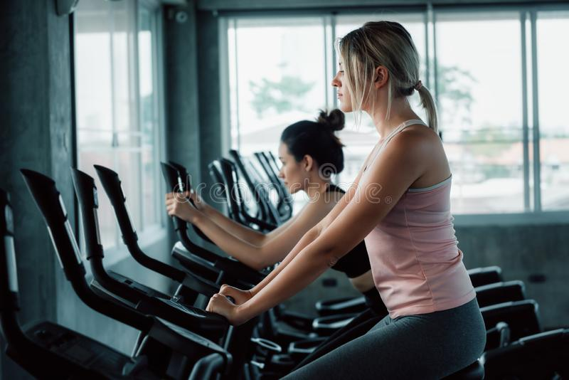 Woman Workout Cycling Exercise in Fitness Club, Portrait of Pretty Attractive Caucasian Woman Cycling Training in Gym., Beautiful royalty free stock photo