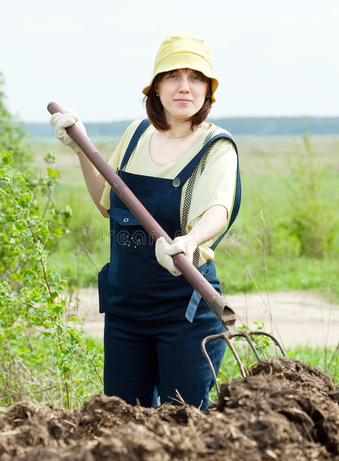 Woman Works With Animal Manure Stock Photos