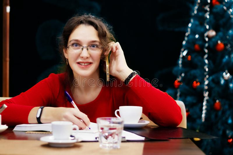 Woman works in the Christmas and New Year holidays royalty free stock images