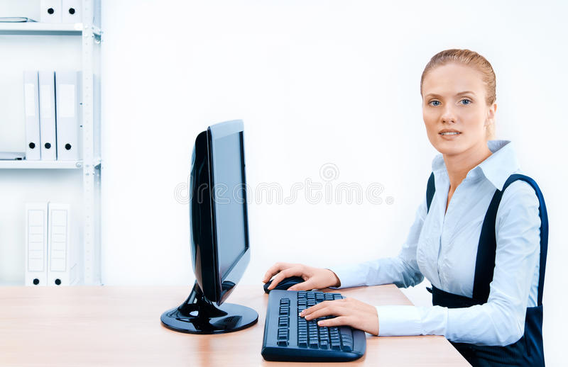 Woman works at the computer. royalty free stock images
