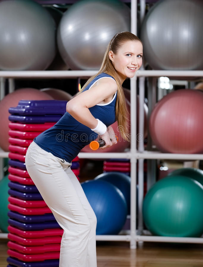 Woman works out with gymnastic stick. Woman in sportswear works out with gymnastic stick to keep fit stock photos