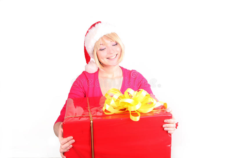 Woman wrapping christmas presents wearing santa ha