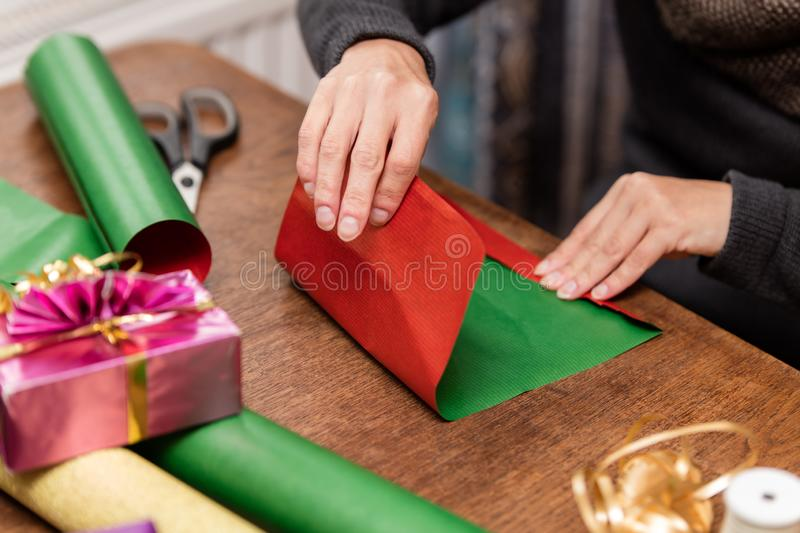 Woman is wrapping colorful gifts stock photography