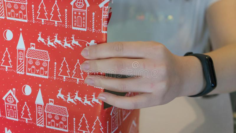 Woman wrapping and decorate a gift box for christmas festive. Hand Packaging a surprise to celebrate xmas party stock photography