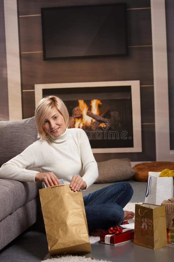 Woman wrapping presents royalty free stock photo