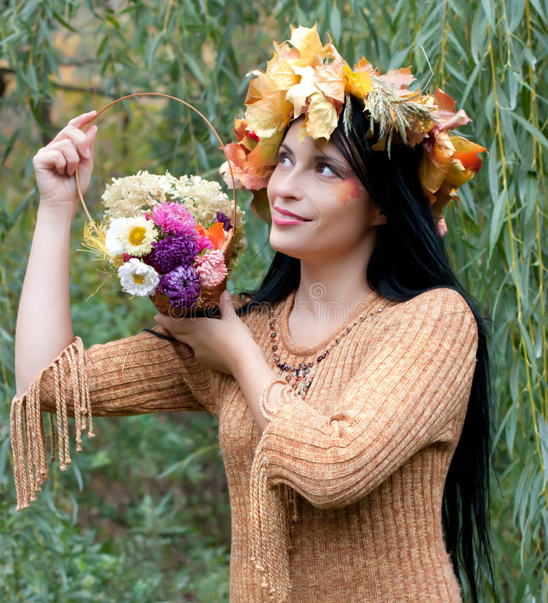 Download Woman In A Wreath Of Autumn Leaves Stock Photo - Image: 27075834