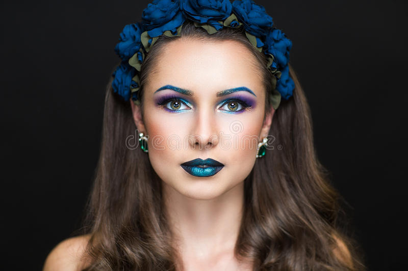 Woman with wreath of blue roses stock photos