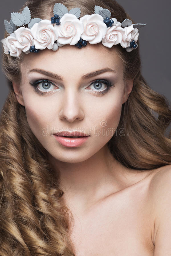 Download A Woman With A Wreath Of Flowers On Her Head Stock Photo - Image: 39423702