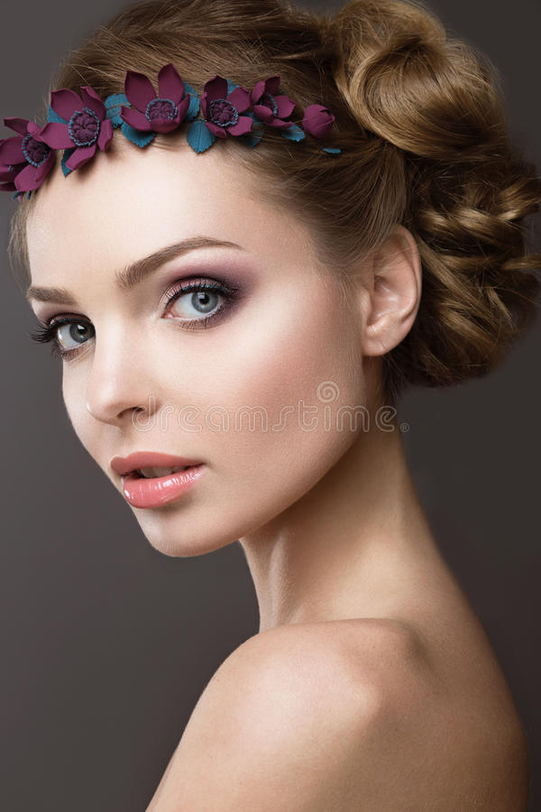 Download A Woman With A Wreath Of Flowers On Her Head Stock Image - Image: 39423761