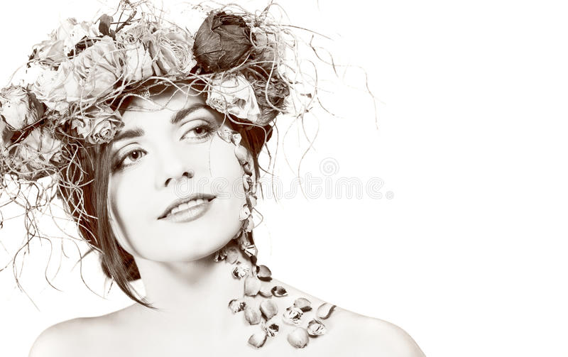 Woman with wreath on her head stock photo