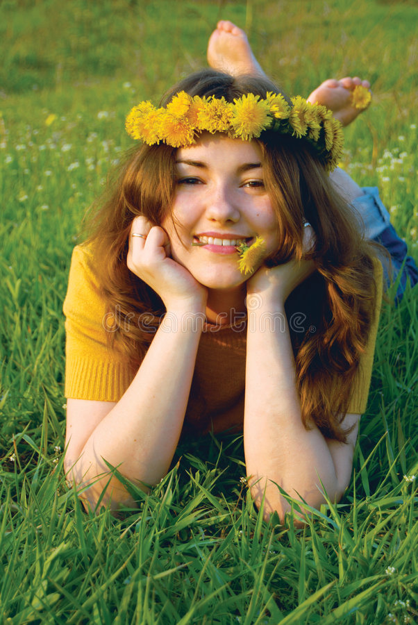 Woman in a wreatht from dandelions stock image
