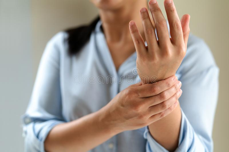 Woman wrist arm pain long working. office syndrome healthcare and medicine concept royalty free stock photo